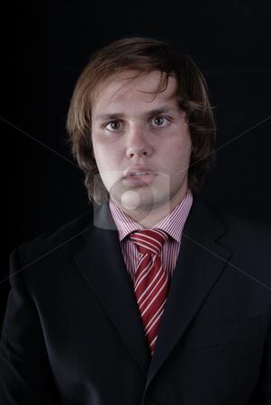 Portrait stock photo, Young business man portrait on black background by Rui Vale de Sousa