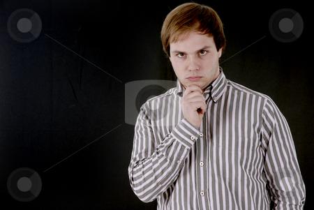 Attitude stock photo, Young business man portrait in a dark background by Rui Vale de Sousa