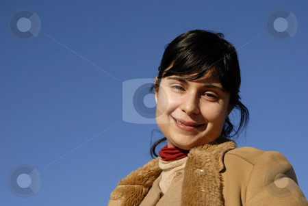 Woman stock photo, Young woman close up portrait ans the blue sky by Rui Vale de Sousa
