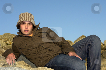 Male stock photo, Young man at the rocky beach with a hat by Rui Vale de Sousa