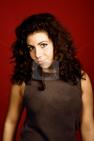 Teen stock photo, Young woman portrait isolated on red background by Rui Vale de Sousa