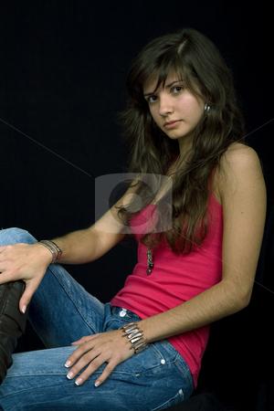 Girl stock photo, Young beautiful brunette portrait against black background by Rui Vale de Sousa