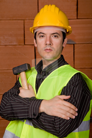 Hammer stock photo, Man with yellow hat with a brick wall as background by Rui Vale de Sousa