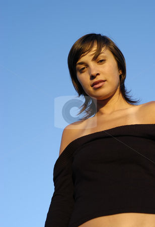 Girl stock photo, Young woman with the blue sky as background by Rui Vale de Sousa