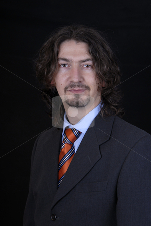 Stand stock photo, Young business man portrait on black background by Rui Vale de Sousa