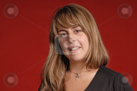 Woman stock photo, Young casual woman portrait on red background by Rui Vale de Sousa