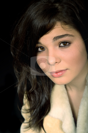 Brunette stock photo, Young beautiful brunette portrait against black background by Rui Vale de Sousa