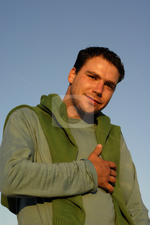 Male stock photo, Young man portrait with the sky as background in sunset light by Rui Vale de Sousa