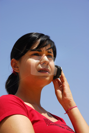 Call stock photo, Young woman calling by phone and the sky by Rui Vale de Sousa