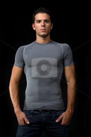 Strong stock photo, Young man portrait, on a black background by Rui Vale de Sousa