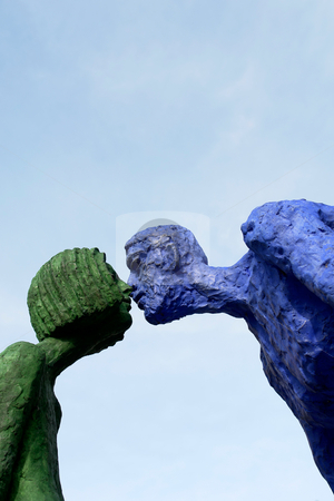 Kiss stock photo, Couple of statues giving a kiss in prague by Rui Vale de Sousa