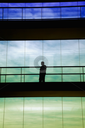 Shape stock photo, Worker inside the modern building in silhouette by Rui Vale de Sousa