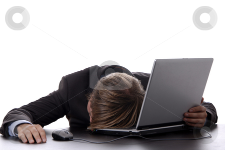 Sleeping stock photo, Young business man sleeping on the laptop by Rui Vale de Sousa