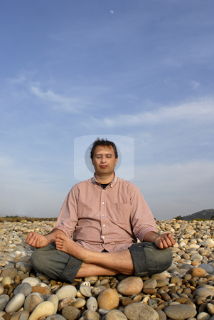 Yoga stock photo, Young man at the beach in meditation by Rui Vale de Sousa