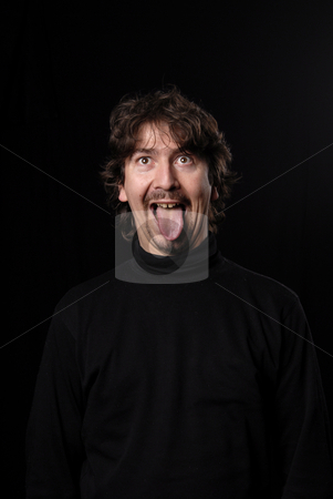Crazy stock photo, Crazy young man portrait isolated on black by Rui Vale de Sousa