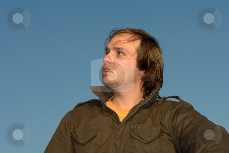 Man stock photo, Young man portrait with the sky as background by Rui Vale de Sousa