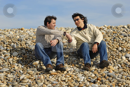 Beach stock photo, Two men at the beach, in a handshake by Rui Vale de Sousa