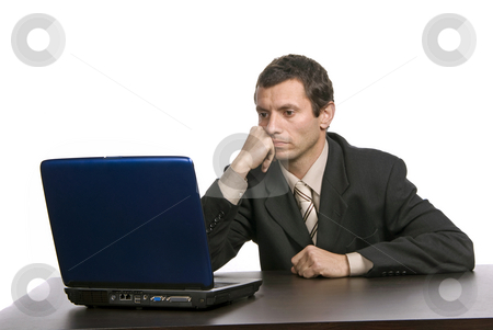 Bored stock photo, Young bored business man working with is laptop by Rui Vale de Sousa