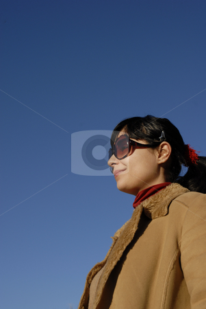 Girl stock photo, Young woman portrait with the sky as background by Rui Vale de Sousa