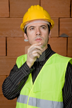 Engineer stock photo, Engineer with yellow hat with a brick wall as background by Rui Vale de Sousa