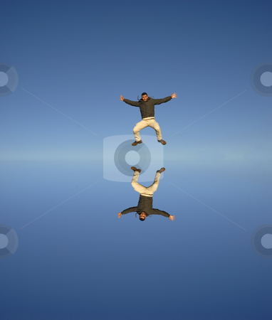 Jump stock photo, Young man jumps high with water reflection by Rui Vale de Sousa