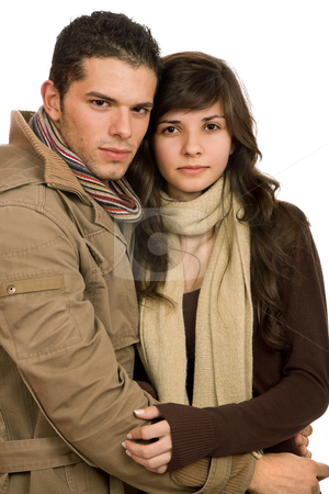 Couple holding each other stock photo, Young casual couple in love isolated on white by Rui Vale de Sousa