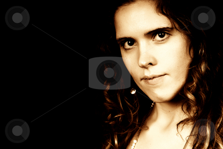 Woman stock photo, Young woman portrait posing in black background, sepia tone by Rui Vale de Sousa
