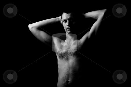 Dark stock photo, Young man portrait on a black background by Rui Vale de Sousa