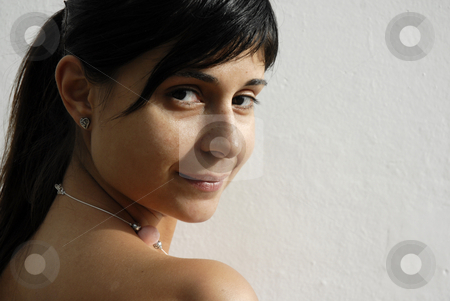Smile stock photo, Girl portrait with a smile in a white wall by Rui Vale de Sousa