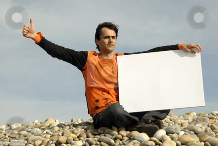 Card stock photo, Young casual man holding white card at the beach by Rui Vale de Sousa
