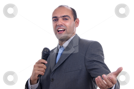 Singing stock photo, Young business man talking on a microphone by Rui Vale de Sousa