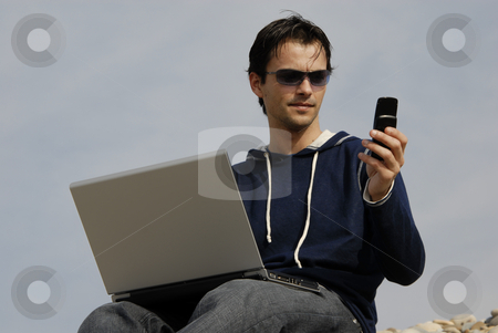 Calling stock photo, Young casual man with laptop at the beach by Rui Vale de Sousa