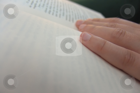 Read stock photo, Hand in a book detail by Rui Vale de Sousa