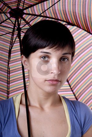 Woman under umbrella stock photo, Young brunette girl with umbrella in colors by Rui Vale de Sousa