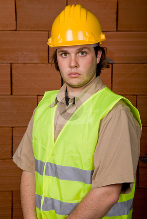 Foreman stock photo, Foreman with yellow hat with a brick wall as background by Rui Vale de Sousa