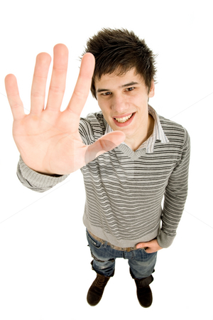 Halt stock photo, Young casual man going stop with the hand, in a white background by Rui Vale de Sousa