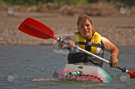 Young Woman Kayaking stock photo, This young adult Caucasian woman is kayaking and is getting worn out and fatigued. by Valerie Garner