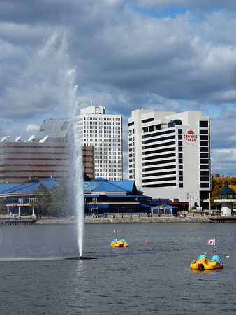 Paddle Boats in Toledo Ohio stock photo, Paddle Boats in Maumee RIver near the fountain in Toledo Ohio. Background buildings include the new Imagination Station Science Center (blue roof building) and one of the downtown hotels. by Dazz Lee Photography