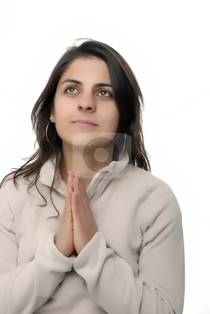 Pray stock photo, Young girl praying in a white background by Rui Vale de Sousa