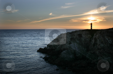 Lighthouse stock photo, Lighthouse sunset at the portuguese coast by Rui Vale de Sousa