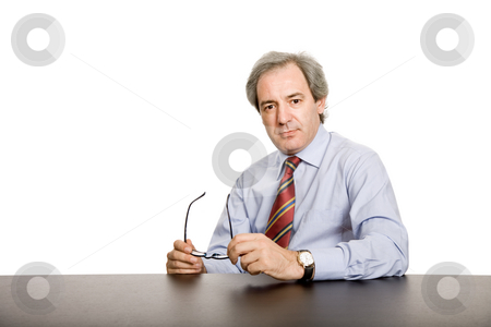 Business man stock photo, Mature business man on a desk, isolated on white by Rui Vale de Sousa