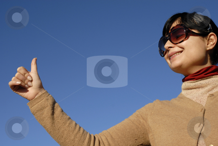 Thumbs up stock photo, Young casual girl portrait in the sun light by Rui Vale de Sousa