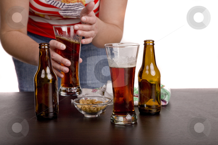 Bar stock photo, Glass of beer with a waitress cleaning on the background by Rui Vale de Sousa
