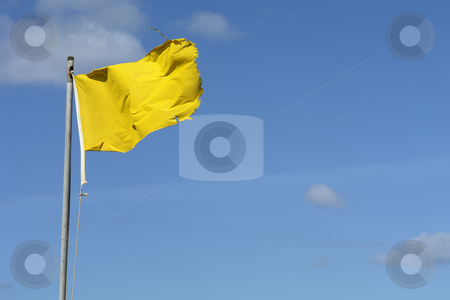 Flag stock photo, Old yellow flag with the sky as background by Rui Vale de Sousa