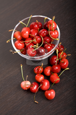 Cherries stock photo, Many cherries in a glass at a table by Rui Vale de Sousa