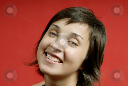Happy stock photo, Young woman portrait isolated on red background by Rui Vale de Sousa