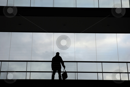 Business stock photo, Businness man in silhouette in a modern building by Rui Vale de Sousa