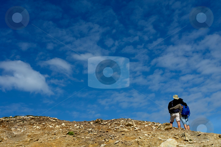 Together stock photo, Young couple looking up together with sky background by Rui Vale de Sousa