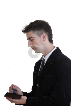 Wireless stock photo, Young business man working with a pda by Rui Vale de Sousa