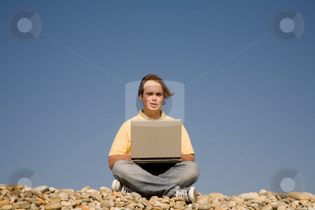 Leisure stock photo, Young casual man with laptop at the beach by Rui Vale de Sousa
